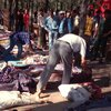 People try to identify relatives after a massacre at Rais in the Sidi Moussa region of Algeria on Aug. 29, 1997.