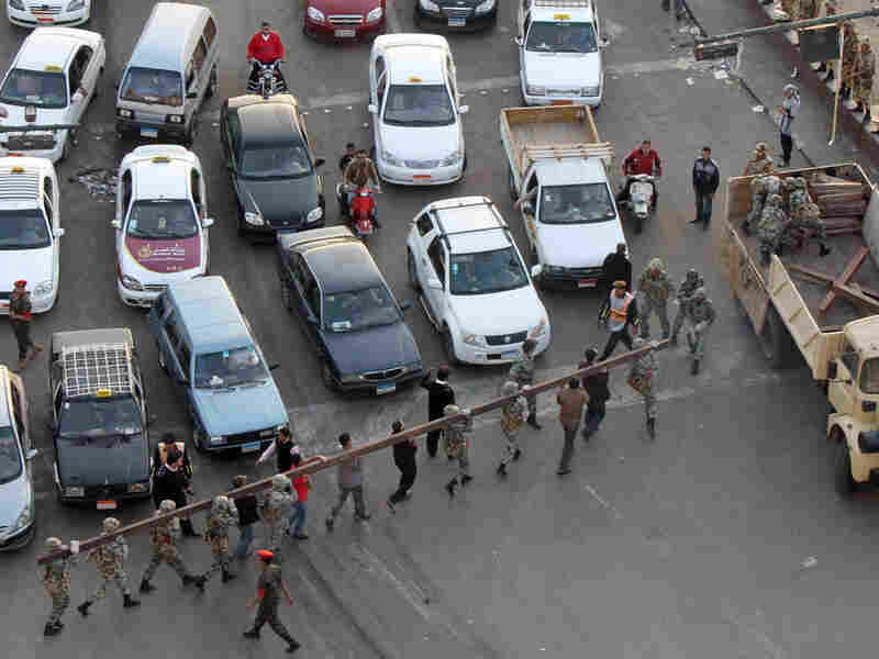 Protesters  shouted slogans criticizing Hosni Mubarak on Wednesday as they demonstrated outside the hospital where  the 82-year-old former Egyptian president was being treated in the Red  Sea resort of Sharm el-Sheikh.