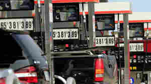 Pumps at a gas station in Laconia, N.H.,  show higher prices for fuel on Monday.