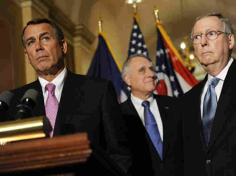 House Speaker John Boehner (from left), with Sen. Jon Kyl (R-AZ) and Senate Minority Leader Mitch McConnell (R-KY), speaks to reporters after meeting with President Obama about the deficit at the U.S. Capitol on Wednesday.