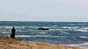 A fishing boat bobs in the waves along the Somaliland coast looking out on the  Gulf of Aden, a favorite area for pirate  attacks.