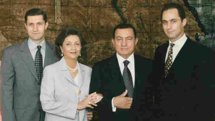 President Hosni Mubarak (second from right) poses with his wife, Suzanne, and their two sons, Gamal (right) and Alaa, in this undated photograph.