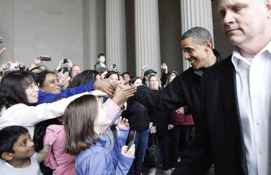 President Obama greets tourists at the Lincoln Memorial, Saturday, April 9, 2011.