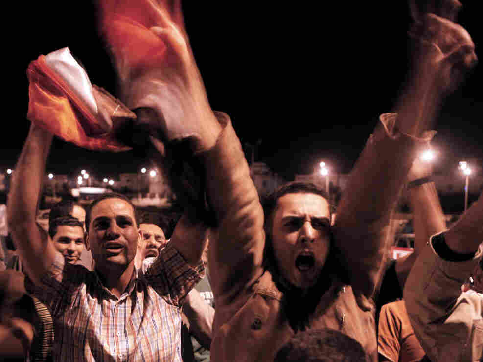 Some Egyptians celebrated today (April 13, 2011) outside the Sharm el-Sheikh courthouse where former President Hosni Mubarak's sons Alaa and Gamal were being questioned.