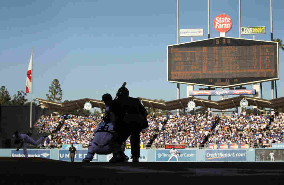 Clayton Kershaw throws a pitch against the San Francisco Giants on Opening Day at Dodger Stadium on March 31.