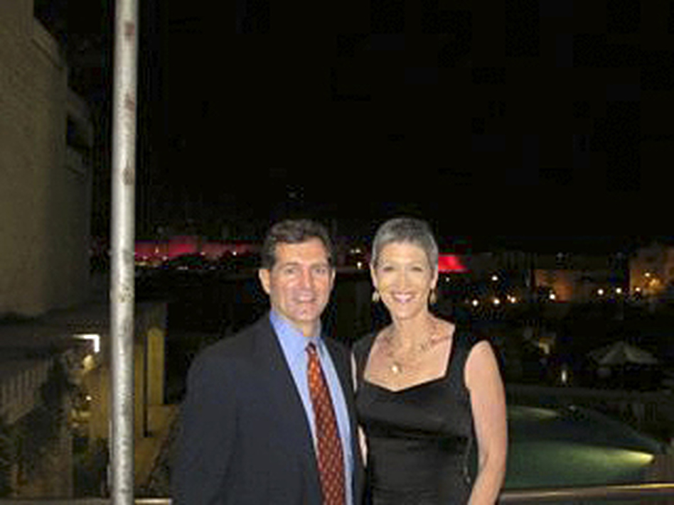 Greg Myre and Jennifer Griffin returned to Jerusalem last October, for a Race For The Cure breast cancer event. The walls of Jerusalem's Old City are in the far background, lit by pink lights for the occasion. (Greg Myre and Jennifer Griffin)