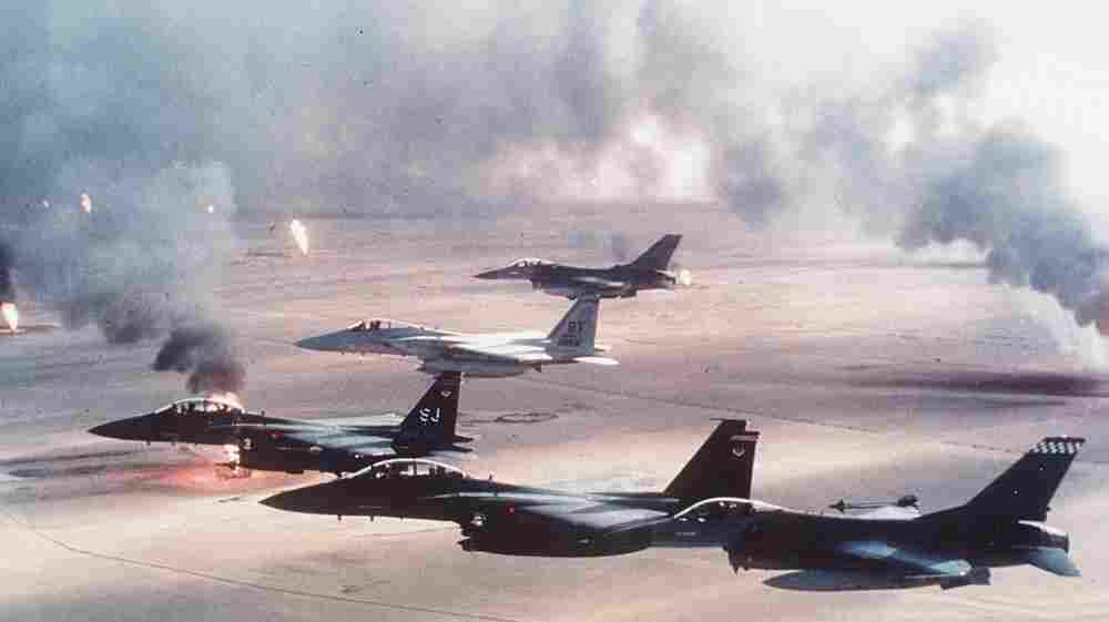 U.S. warplanes fly over burning oil wells in Kuwait during Operation Desert Storm in 1991.