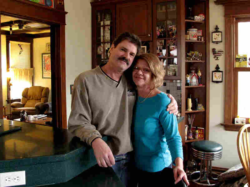 Lisa Howland says her husband, Randy, smiles a lot more now that he's working, even though the job doesn't pay enough to cover all their bills.