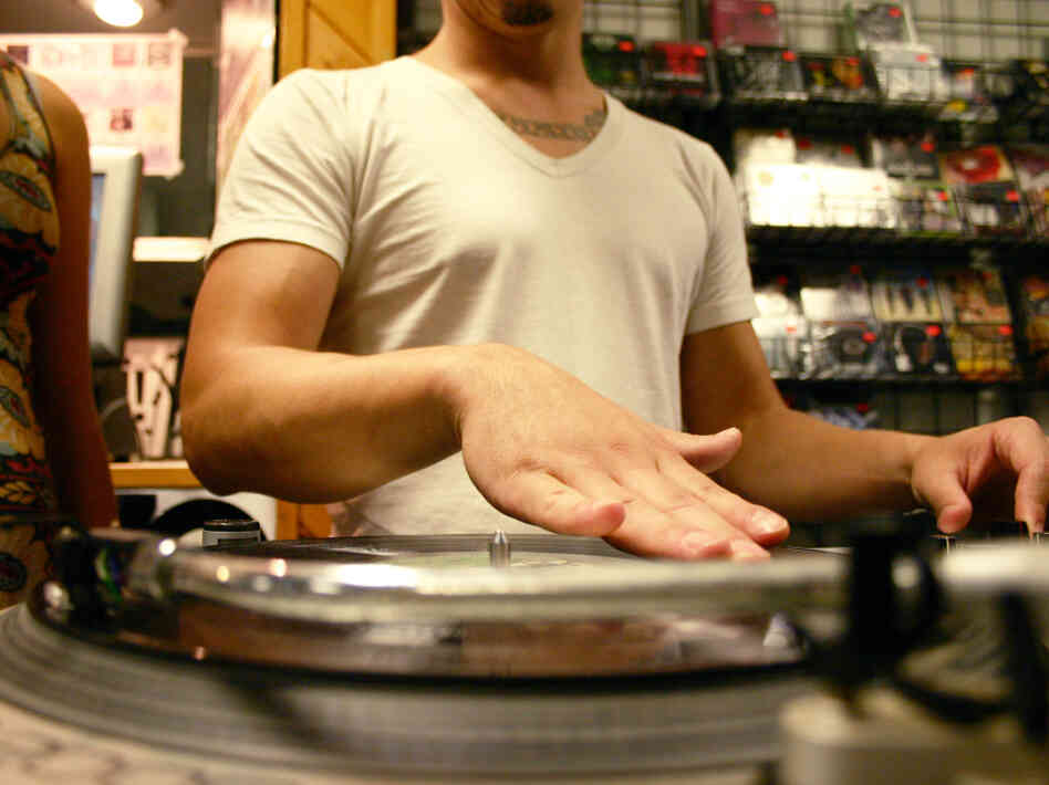 DJ Miguel Emmanuelli scratches a record at CD Connection in Jacksonville Beach, Fla., in 2008.