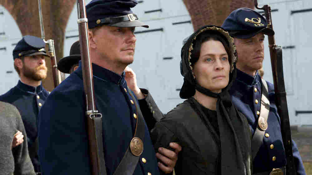 "Robin Wright plays Mary Surratt with a sense of ""essential decency,"" says movie critic David Edelstein. Wright stars in Robert Redford's movie about the real-life trial of the woman who ran the Washington boarding house where John Wilkes Booth regularly stayed."