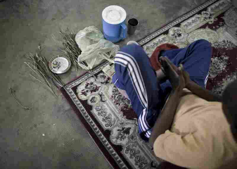 A sufi prays in a shrine. Sufis in Somaliland often chew khat while praying. Sufism has deep roots in Somaliland and many in Somaliland feel the Islamic pressure building in Somalia as a threat to Somaliland's more moderate and tolerant view of Islam.