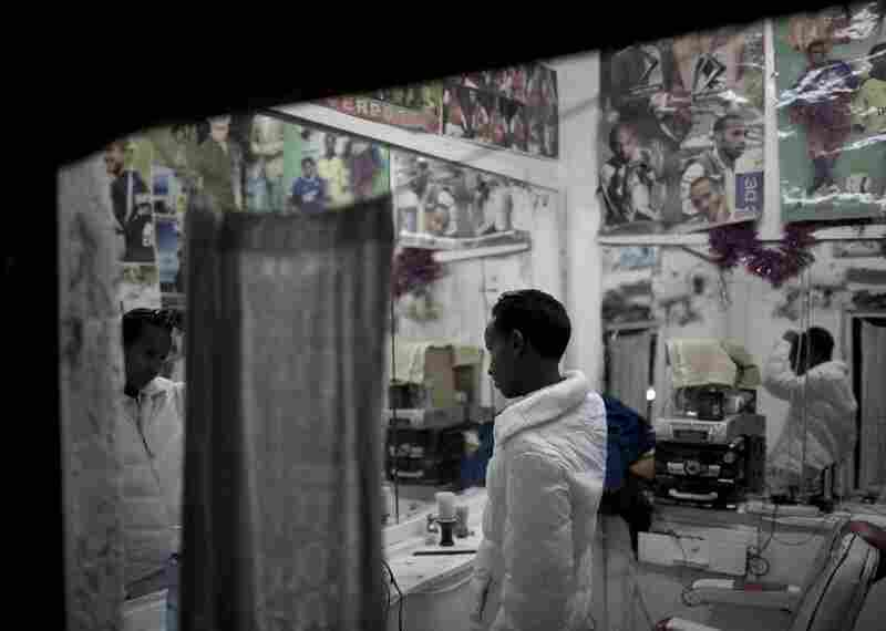 A young Somali checks himself out and fixes his hair in the mirrors of a small barbershop in Hargeisa.