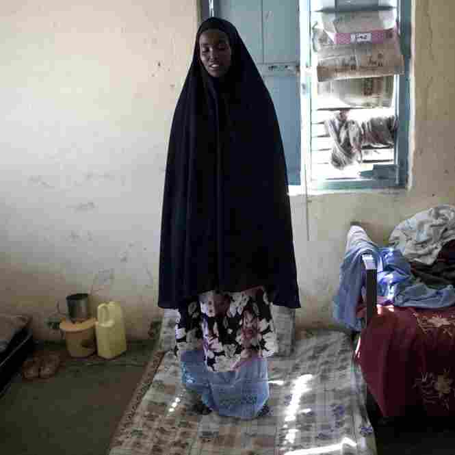 A young woman stands silently on her bed in the Hargeisa mental hospital, the only such hospital in all of Somaliland. Maybe people are still affected by the breakway war with Somalia.