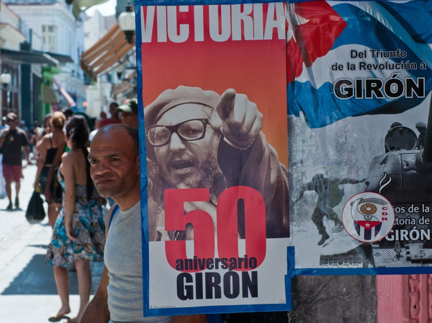 Posters commemorate the 50th anniversary of the Bay of Pigs in Havana on April 13. This weekend's Cuban Communist Party Congress is timed with the anniversary in mind.