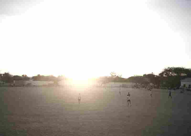 Men play soccer in Hargeisa.
