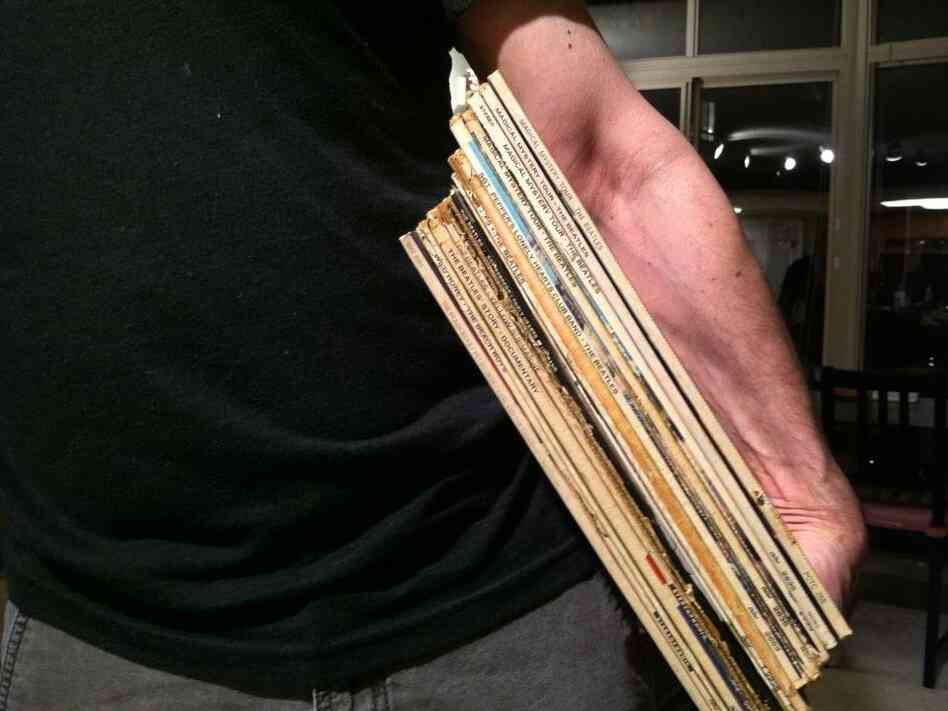 Bob Boilen holds an armful of records.