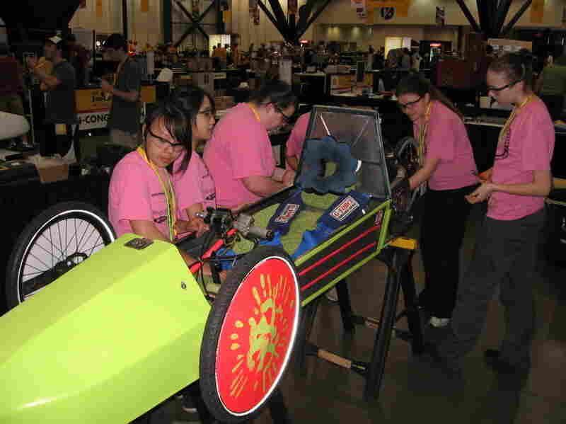 The ShopGirls, from Granite Falls High School in Granite  Falls, Wash., prepare their car for the annual Shell Eco-marathon on Saturday at the George R. Brown Convention  Center in Houston.
