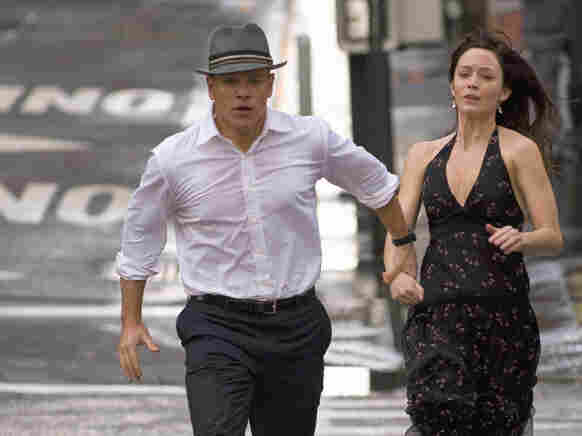 On The Run: Aided by a portal-opening fedora, David Norris (Matt Damon) and Elise Sallas (Emily Blunt) attempt to escape the heavy hand of fate in The Adjustment Bureau.