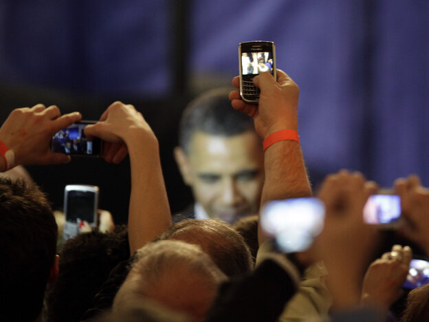 Supporters take photos of President Obama at a Chicago fundraising event, Thursday, April 14, 2011.