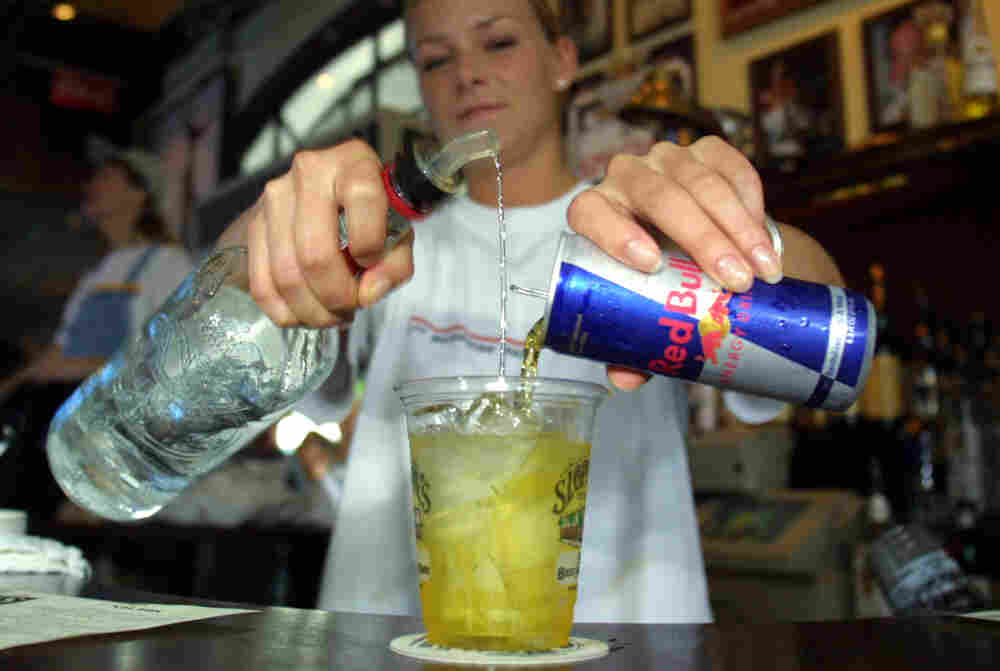 """A bartender mixes a Red Bull energy drink with vodka in Key West, Fla. A can of Red Bull has more than double the caffeine of a can of coke. """"It changes how you experience the drink,"""" a psychologist says."""