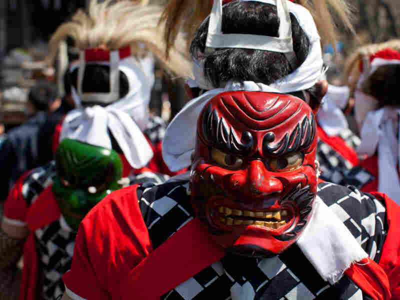 A Japanese performer wears a devil mask during an April 17 ceremony at a temple in Rikuzentakata.