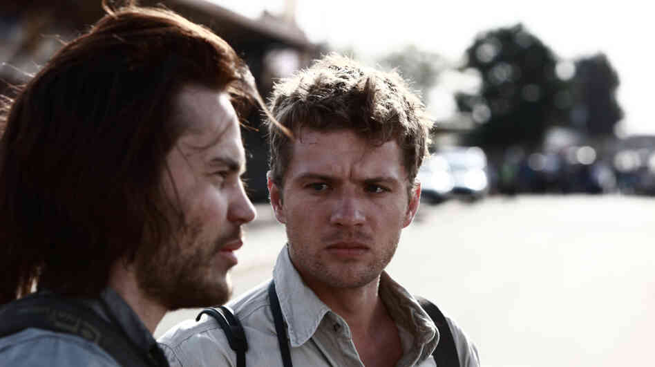 Triggermen: Greg Marinovich (Ryan Phillippe, right) and Kevin Carter (Taylor Kitsch) are two of the four combat photographers who made a name for themselves as the Bang Bang Club.
