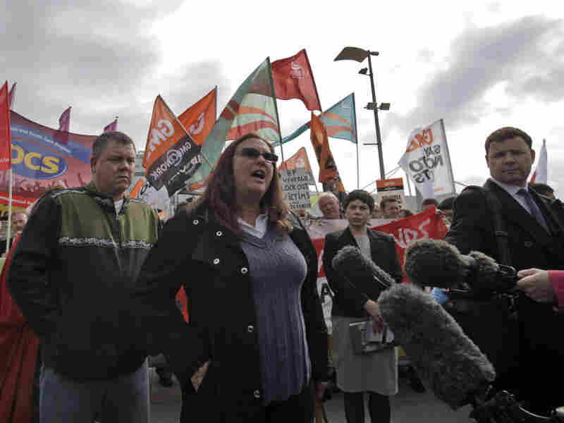 Tracy Kuhms, a fishing boat owner from Louisiana who was affected by last year's oil spill, talks to members of the media last week outside the London conference center where BP held its annual general meeting of shareholders.