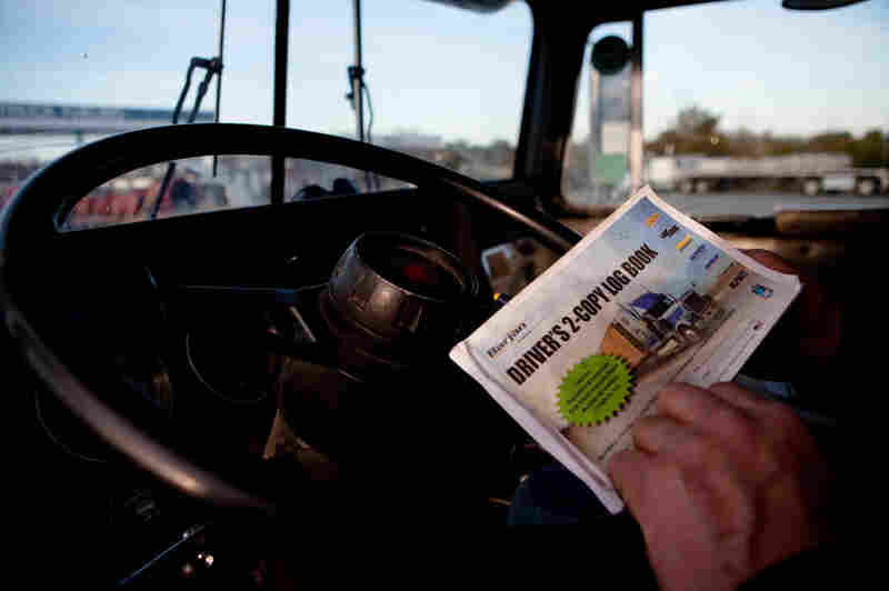 Paper log books, like this one used by trucker Terry Button, can be purchased at truck stops for as little as $1.49. Electronic monitors can cost more than $1,500.