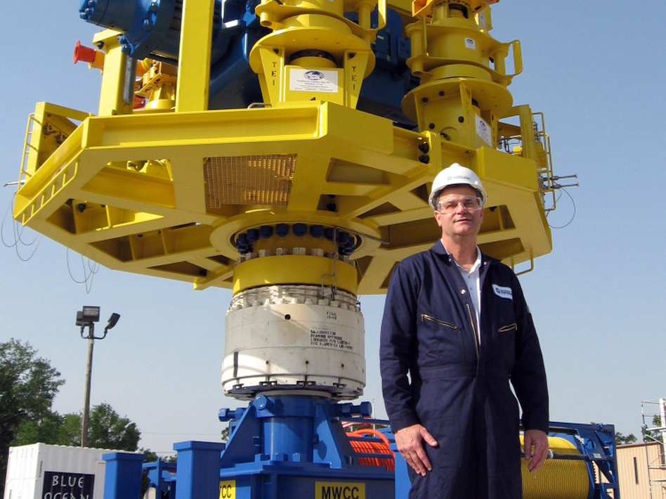 Dan Smallwood, chief operating officer for Marine Well Containment Co., stands in front of a capping stack that would be placed over an oil well to cap it off in an emergency.