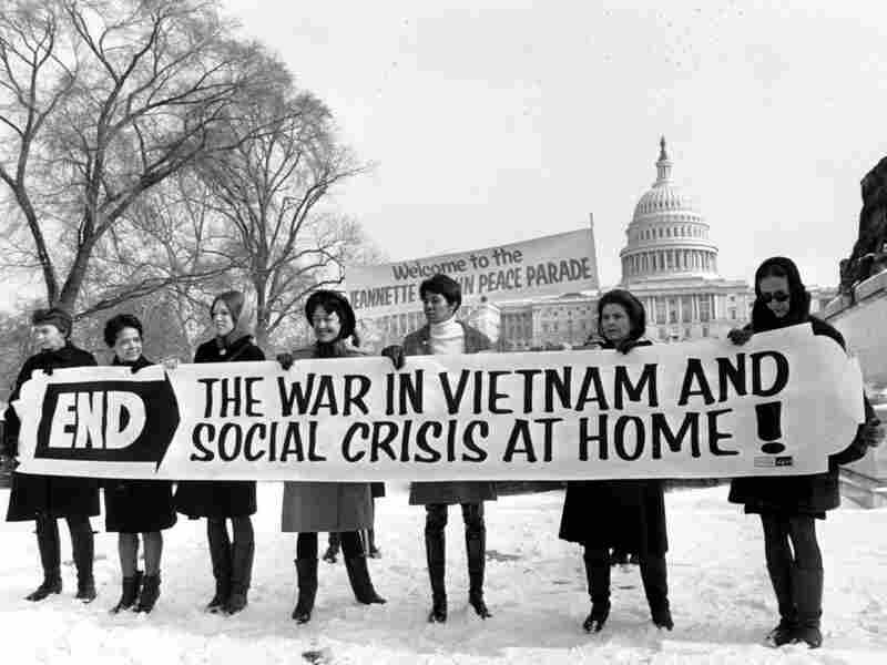 Members of a women's brigade hold a banner protesting the Vietnam War at a march led by former Montana Rep. Jeannette Rankin in 1968.