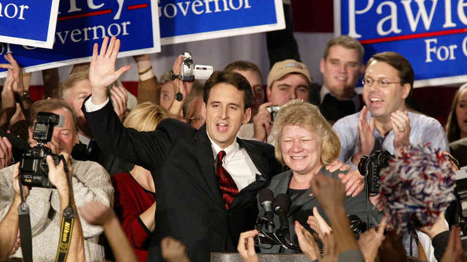 Then-gubernatorial candidate Tim Pawlenty and running mate Carol Molnau celebrate their victory at Republican election headquarters on Nov. 6, 2002, in Bloomington, Minn. The former governor says he was inspired by Ronald Reagan — someone who wasn't considered such a hero 30 years ago in Pawlenty's blue-collar neighborhood.
