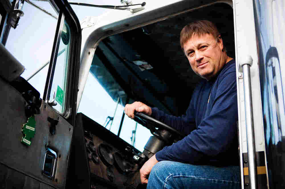 """Trucker Terry Button is opposed to onboard trucker monitors that would be able to detect when his truck is in motion. """"I can't think of anything good that would come from this. If I could, I would tell you honestly, and I can't,"""" he says."""