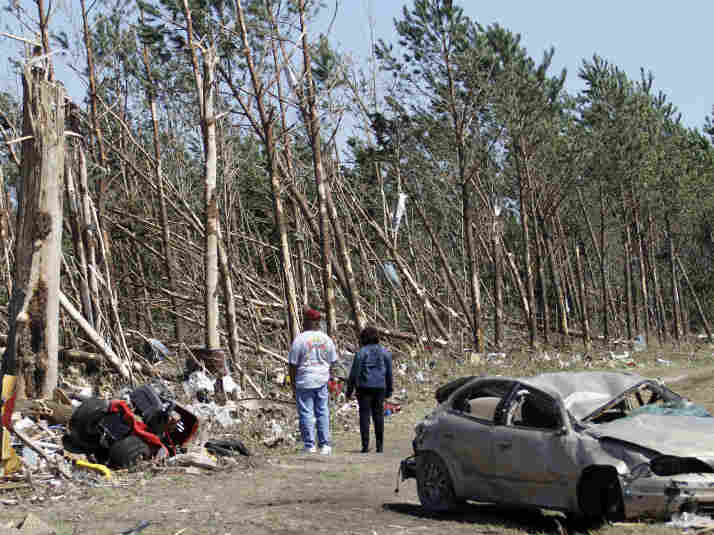 Passers-by inspect tornado damage Sunday in Askewville, N.C. Rescue crews searched for survivors in wind-blasted landscapes throughout the day Sunday and into Monday in North Carolina, the state hardest hit by a storm system that spawned dozens of tornadoes from Oklahoma to Virginia.