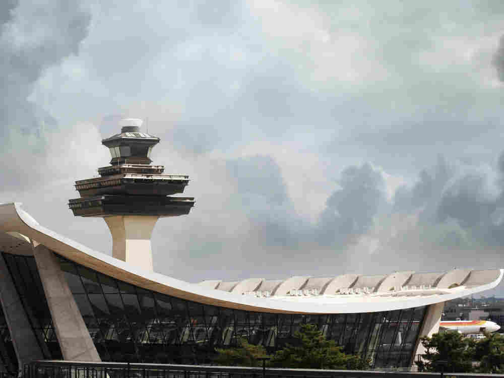 The air traffic control tower at  Dulles International Airport in Virginia. The  Federal Aviation Administration has issued new rules for air traffic controllers  after a spate of incidents exposed controllers sleeping on the job.