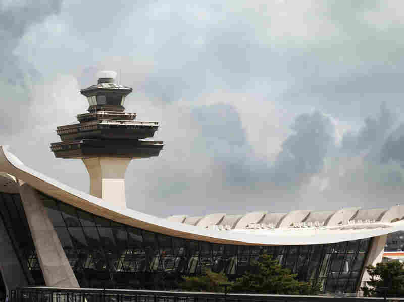 The air traffic control tower at Virginia's Dulles International Airport. The Federal Aviation Administration has issued rules for air traffic controllers after a spate of incidents exposed controllers sleeping on the job.