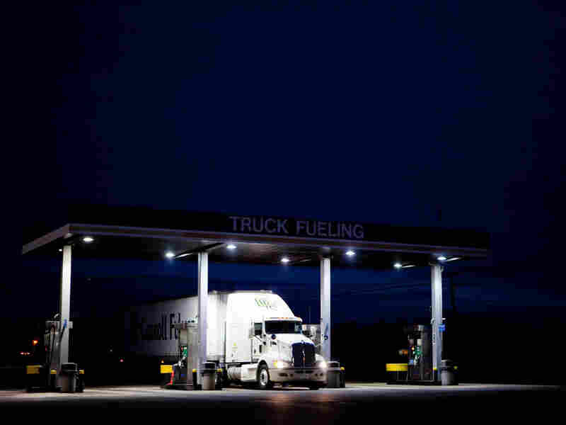 Current laws say that truckers are not supposed to work for more than a 14-hour stretch; only 11 of those hours can be driving hours. Advocates of electronic truck monitors say the technology could help reduce highway accidents.