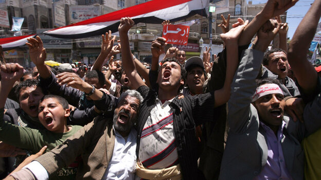 Yemeni anti-government protesters shout slogans during a demonstration against President Ali Abdullah Saleh's regime on April 18, in Sanaa.
