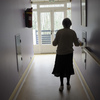 A woman with Alzheimer's disease walks in a corridor at a retirement house in Angervilliers, France, last month.