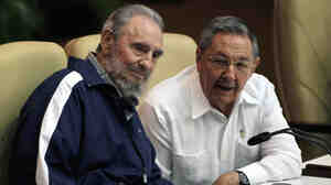 Fidel Castro, left, and his brother Raul at today's Communist Pa