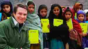 Greg Mortenson, the author of Three Cups of Tea and Stone Into Schools, poses with Nowseri schoolchildren in Azad Kashmir, Pakistan.