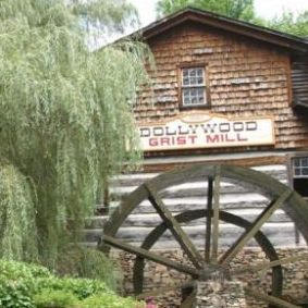 The train goes by the Grist Mill at Dollywood.