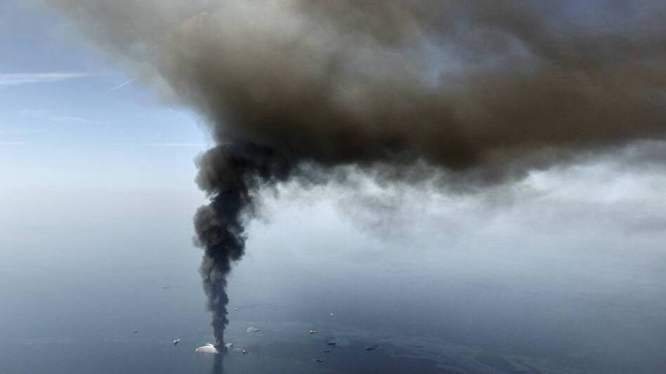 The Deepwater Horizon oil rig burns in the Gulf of Mexico, April 21, 2010. Investigations before and after the disaster found the agency responsible for overseeing the industry quite friendly with those it regulated.
