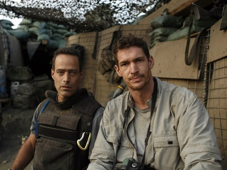 Award-winning photojournalist Tim Hetherington (right) known for his work in war zones, died Wednesday in the Libyan city of Misrata when he was hit by a mortar round. He is pictured here with Sebastian Junger, his co-director of the film Restrepo, which was nominated for the best-documentary Oscar this year.