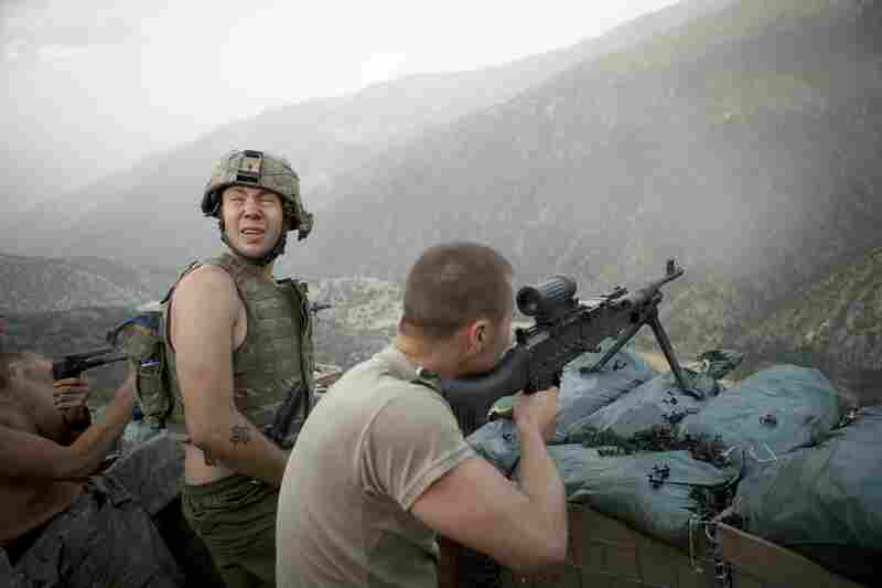 Tim Hetherington and Sebastian Junger jointly directed, filmed and produced the film Restrepo from June 2007 to January 2010. In this image, Specialist Misha Pemble-Belkin (left) and fellow soldiers from Battle Company, 173rd US Airborne, are seen during a firefight at Outpost Restrepo during combat in Afghanistan's Korengal Valley.