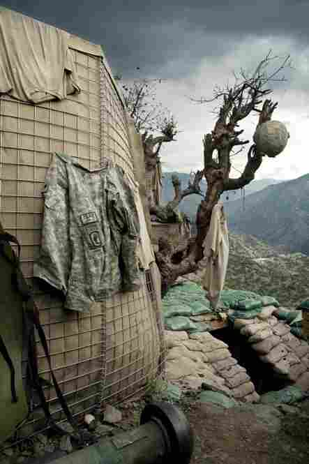 Clothes hang out to dry as rain clouds gather over the Restrepo bunker high up on the edges of the Korengal Valley.