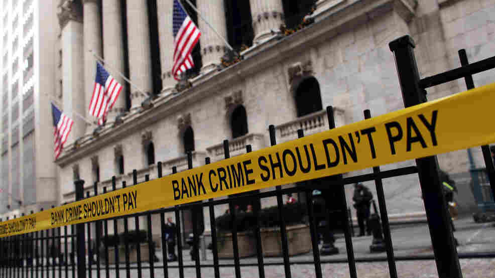 Yellow tape hangs on a fence during a protest outside the New York Stock Exchange last December. Almost three years after the financial crisis, most top Wall Street executives haven't faced any criminal reckoning.