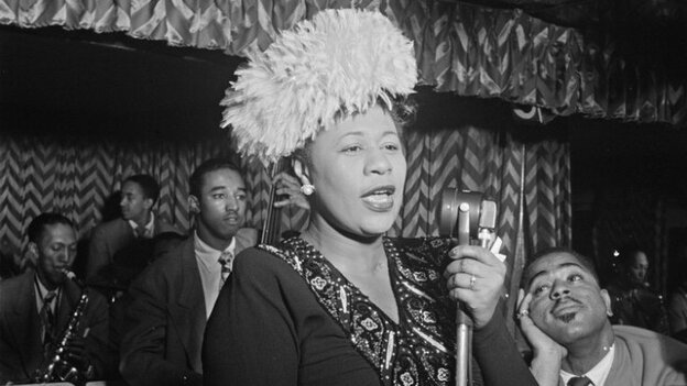 Ella Fitzgerald performs with the Dizzy Gillespie Big Band in 1947. That's Gillespie to her right, in complete awe.