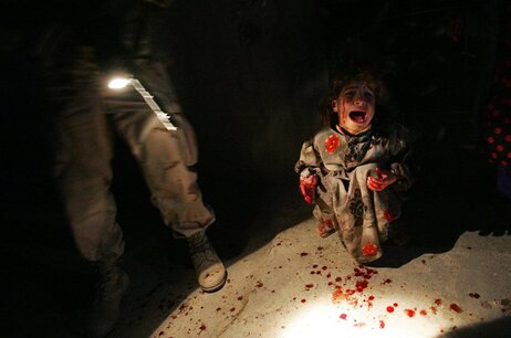 Samar Hassan, 5, screams after her parents were killed by U.S. soldiers with the 25th Infantry Division in a shooting in Tal Afar, Iraq, on Jan. 18, 2005. The troops fired on the Hassan family car when it unwittingly approached them during a patrol in the tense northern Iraqi town.