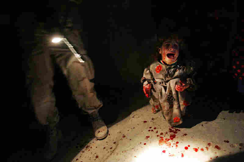 Samar Hassan, 5, screams after her parents were killed by U.S. soldiers with the 25th Infantry Division in a shooting in Tal Afar, Iraq, on Jan. 18, 2005. The troops fired on the Hassan family car when it unwittingly approached them during a patrol in the tense northern Iraqi town. Parents Hussein and Camila Hassan were killed instantly, and a son Racan, 11, was seriously wounded in the abdomen...