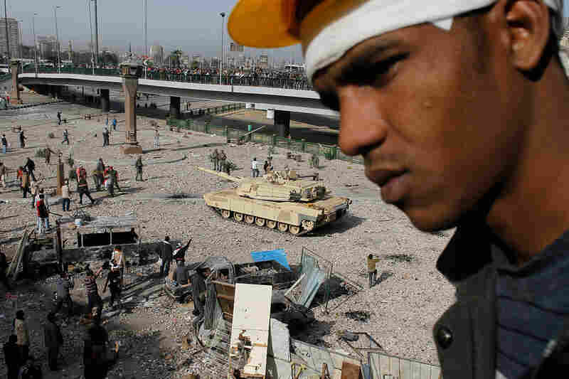 An Egyptian anti-government protester stands on a balcony over the front line between anti- and pro-Mubarak factions on the edge of Cairo's Tahrir Square on Feb. 3.